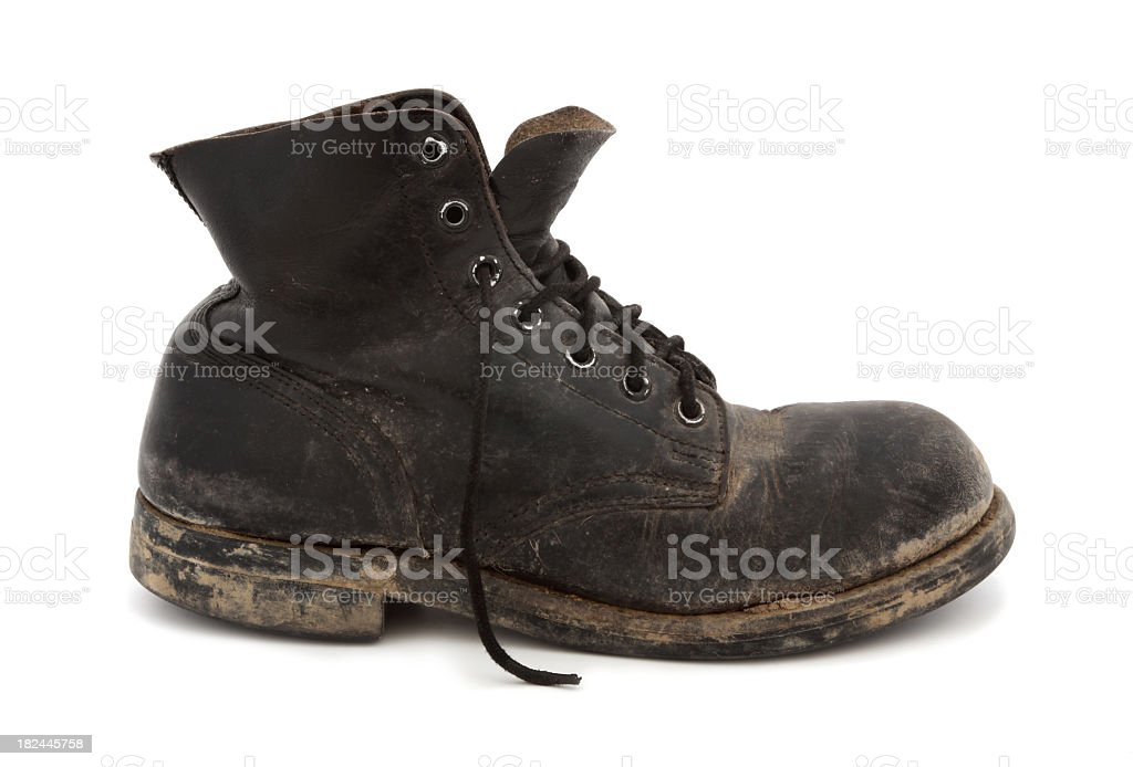 A picture of a muddy, worn out boot royalty-free stock photo