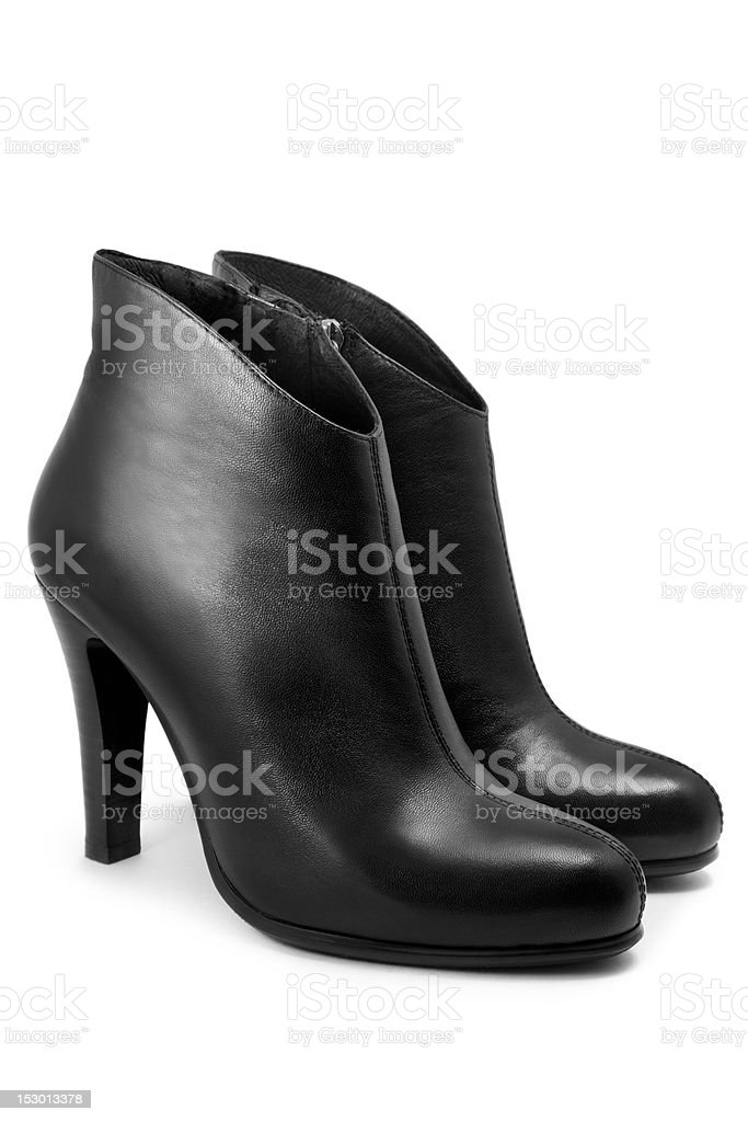 A picture of a pair of black boots on a white background stock photo
