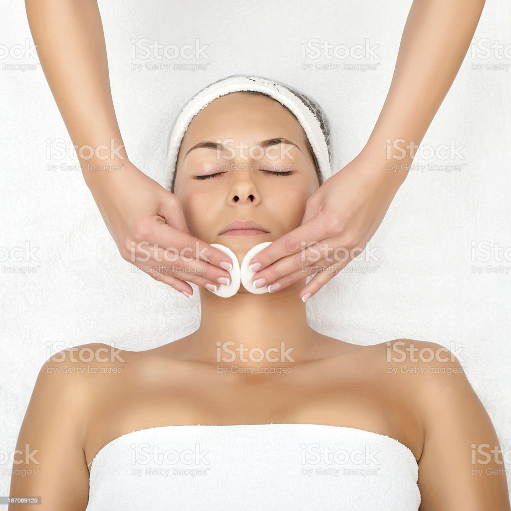 Picture of a person receiving facial exfoliation royalty-free stock photo