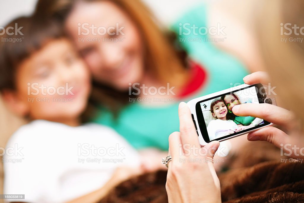 picture of a picture being taken of mother and child royalty-free stock photo