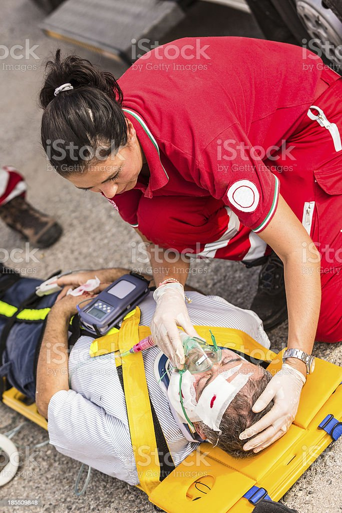 A picture of a rescue team providing first aid stock photo