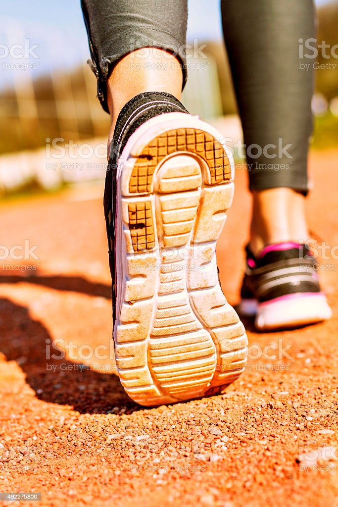 Picture of a runner foot on court. stock photo