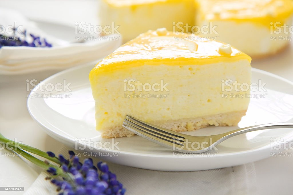 A picture of a slice of lemon mousse cake stock photo