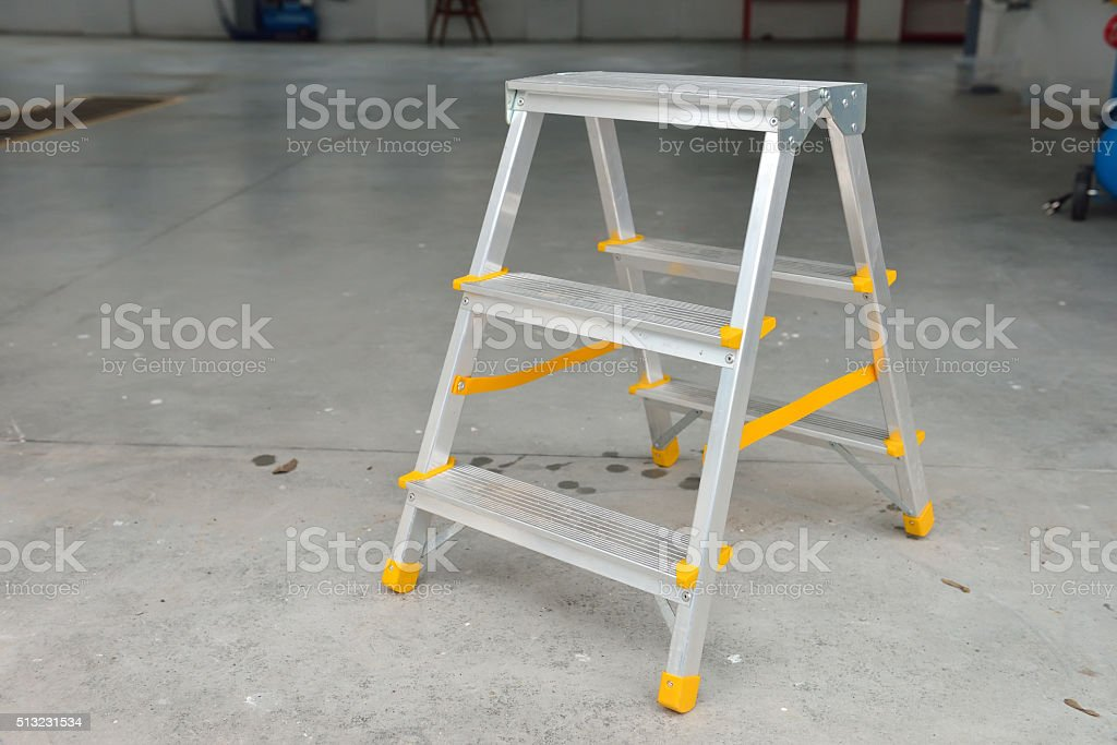Picture of a small foldable ladder in a car wash stock photo