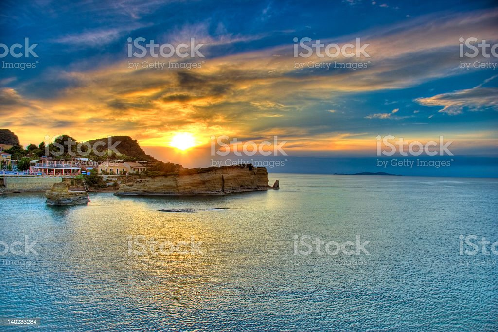 A picture of a sunset overlooking Corfu island royalty-free stock photo