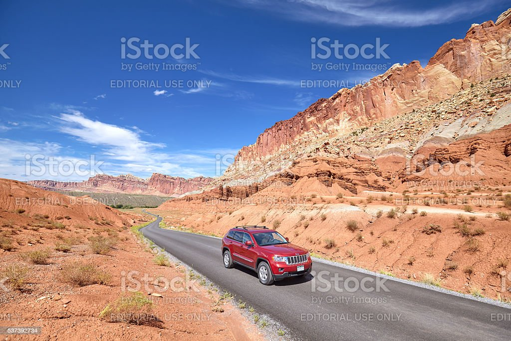 Picture of a SUV on winding road. stock photo