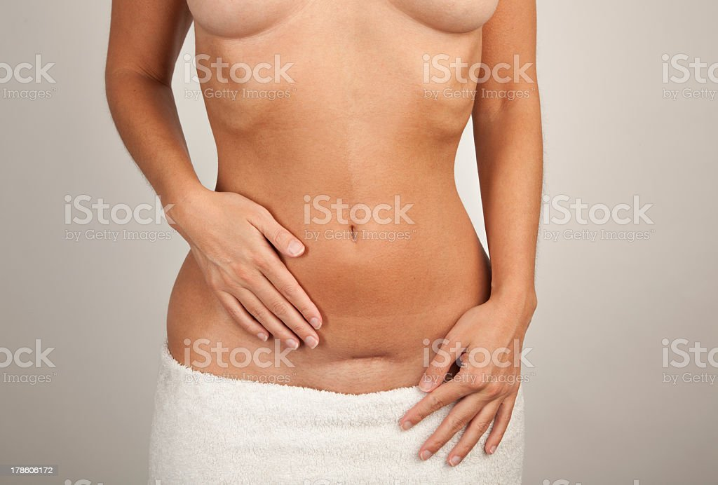 Picture of a topless woman wearing a white towel  stock photo