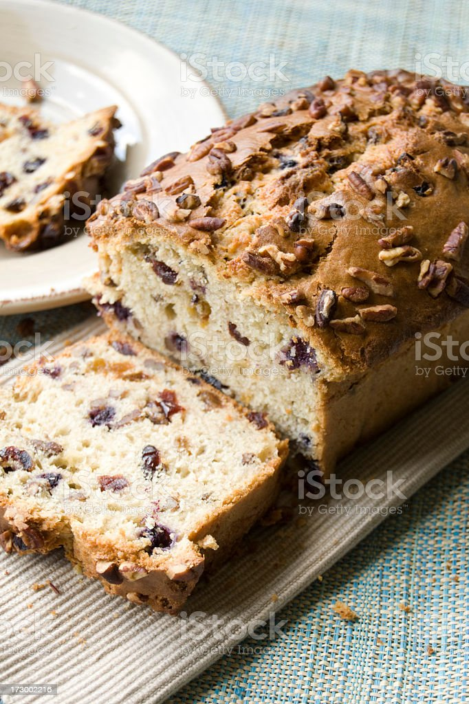 Picture of a traditional banana and nut bread on wood board stock photo