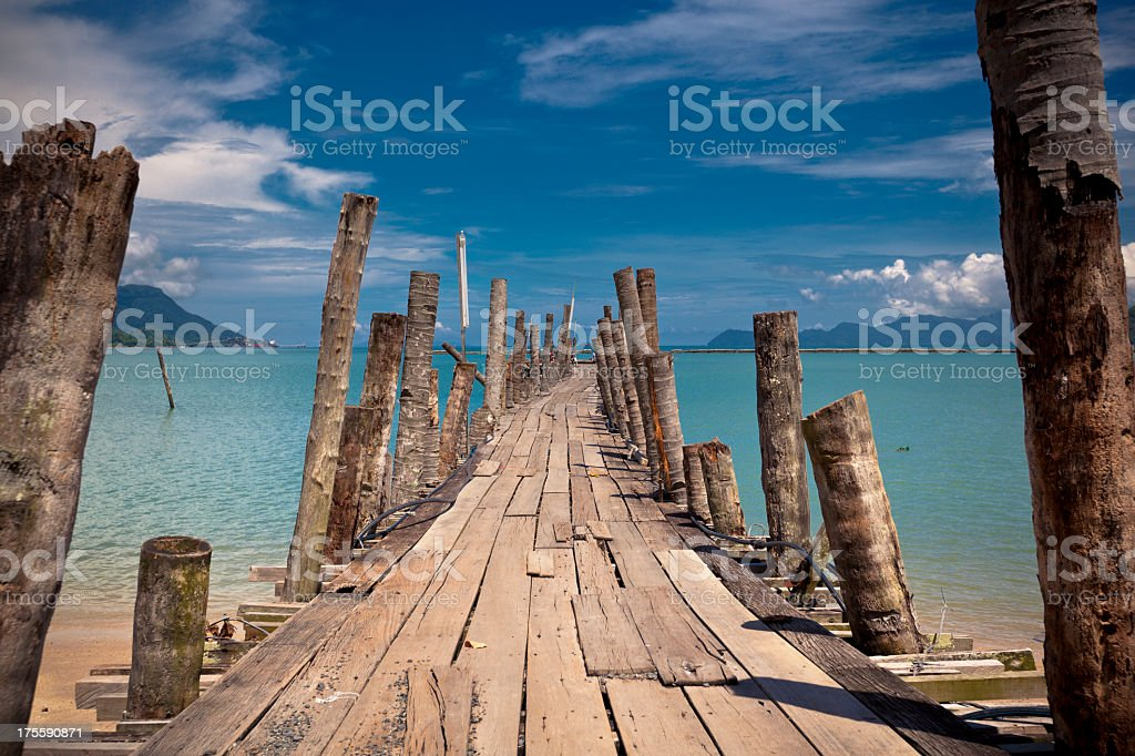 A picture of a wooden bridge on the beach stock photo