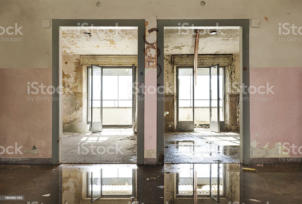 Picture of an abandoned building with water in it stock photo