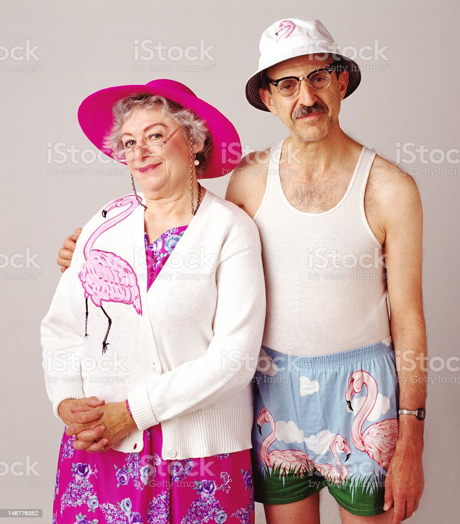 Picture of an elderly quirky couple wearing flamingos stock photo