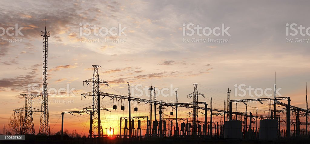 A picture of an electric substation during sunset stock photo