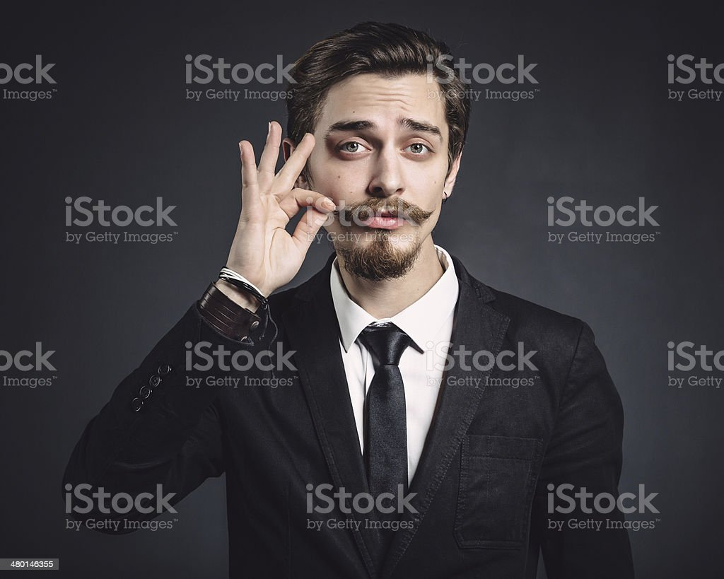 Picture of an elegant young fashion man stock photo