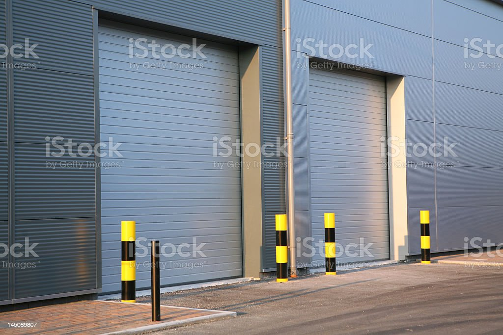A picture of an industrial unit with garage doors closed stock photo
