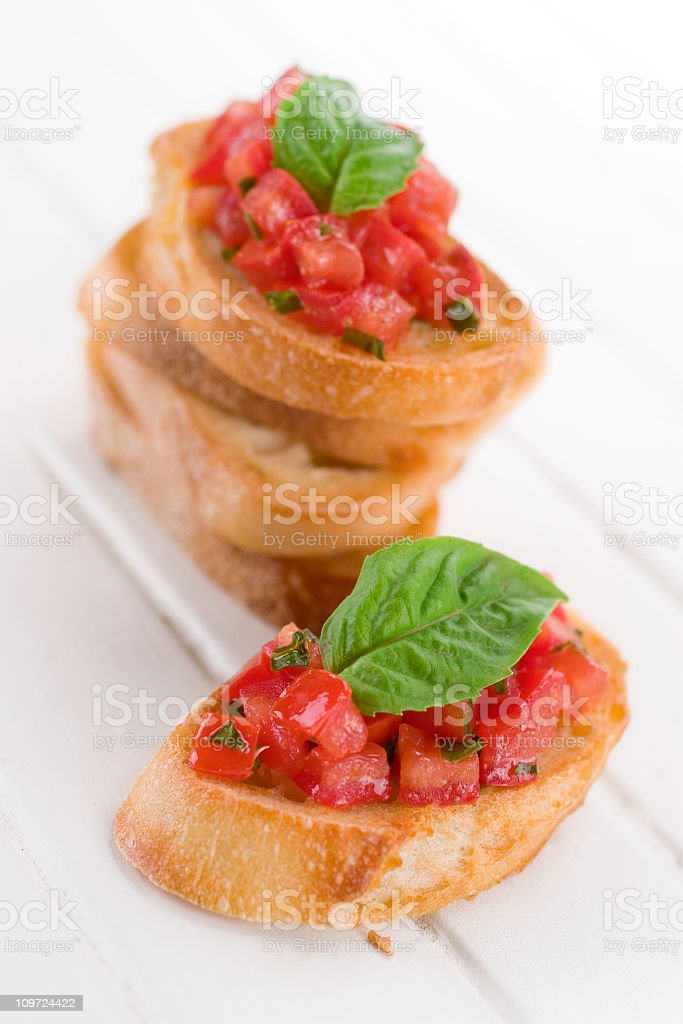 Picture of an Italian dish, Bruschetta, with tomato toppings stock photo