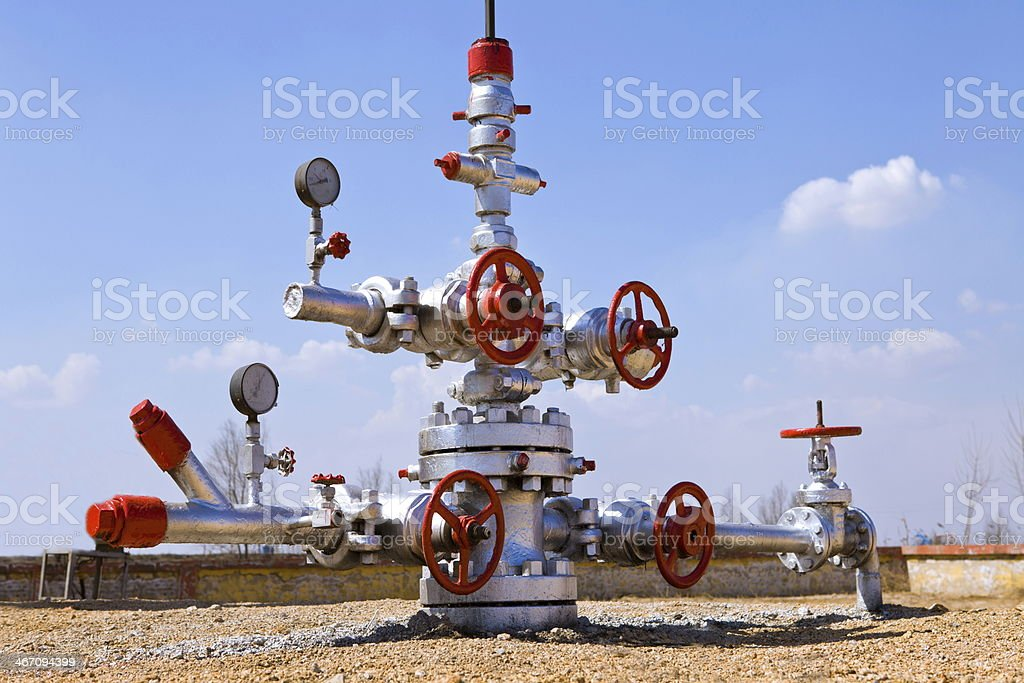 Picture of an oil wellhead with multiple heads stock photo