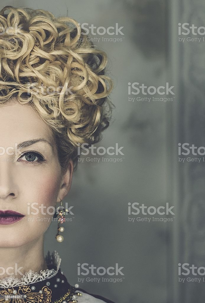 Picture of beautiful haughty queen in royal dress royalty-free stock photo