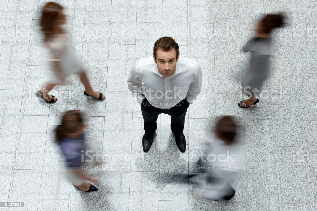 A picture of blurred people surrounding a man royalty-free stock photo