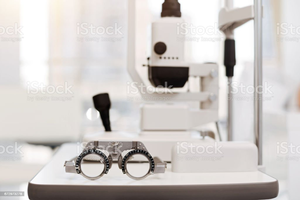 Professional device. Newly appointed eye doctor furnishing his office...