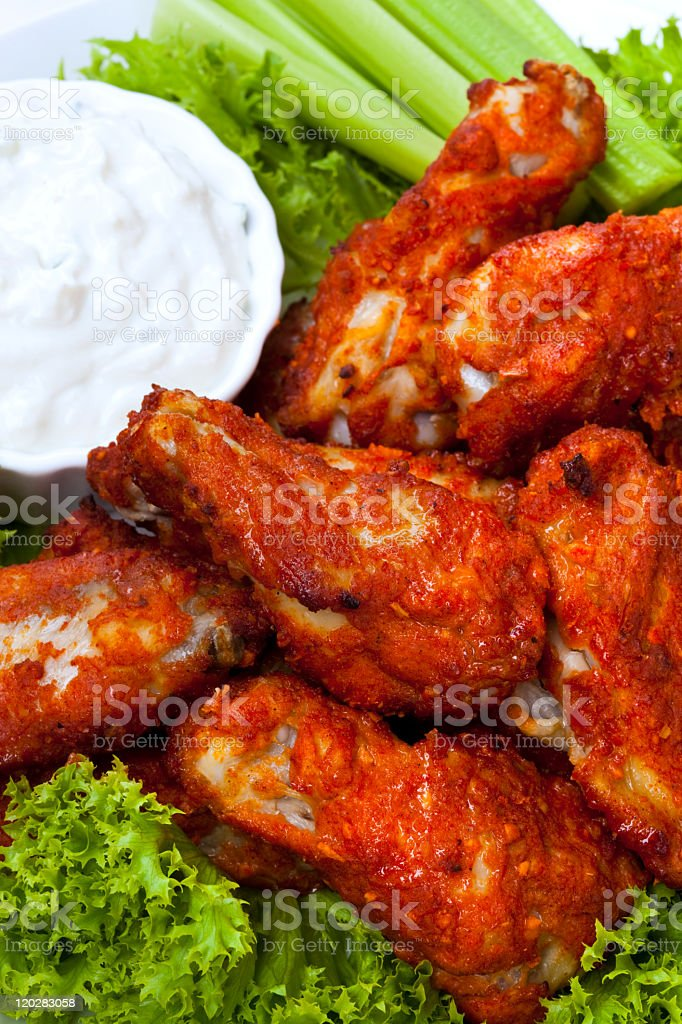 A picture of buffalo wings and ranch stock photo