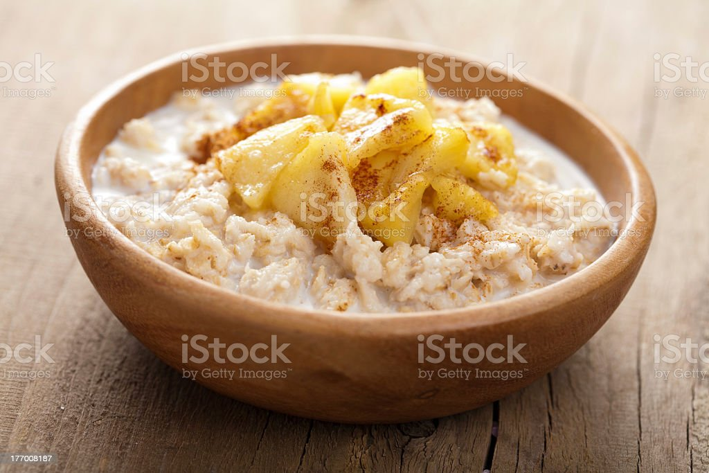 A picture of cereal with apple slices in a bowl royalty-free stock photo