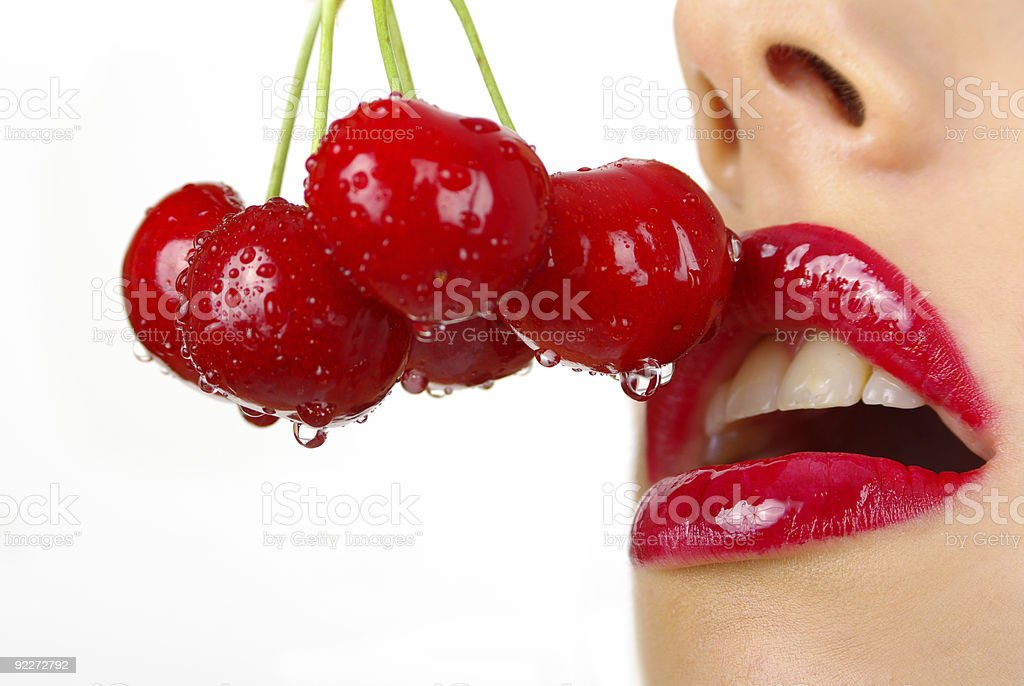picture of cherry and  lips over white stock photo
