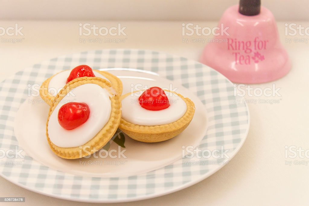 picture of cherry bake well tarts and service bell stock photo