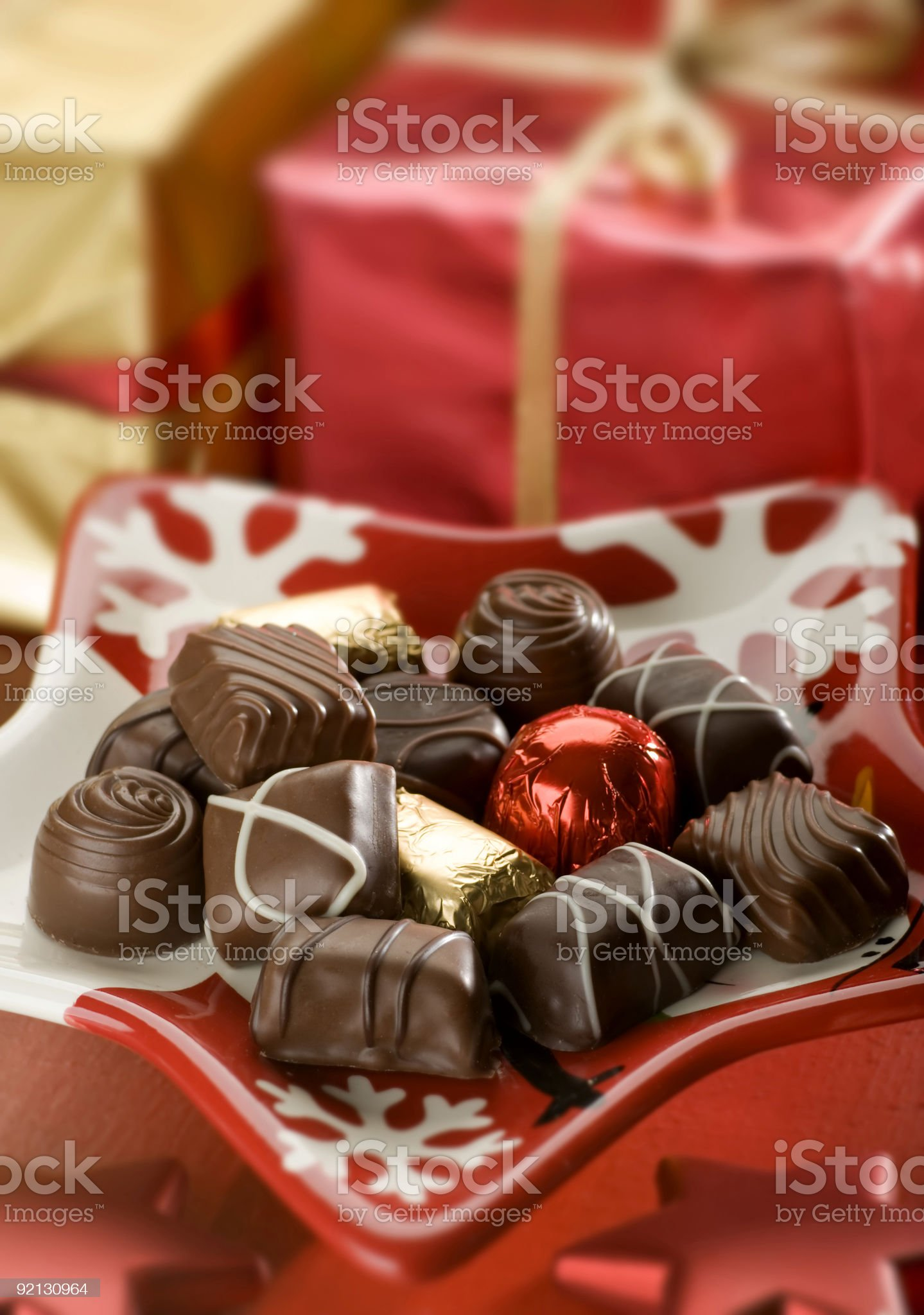 A picture of chocolate candy on a Christmas plate royalty-free stock photo