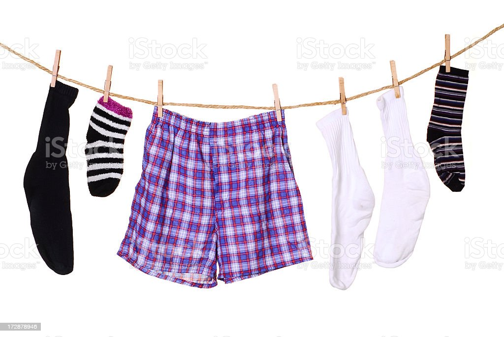 A picture of clothes hanging from a clothes line stock photo