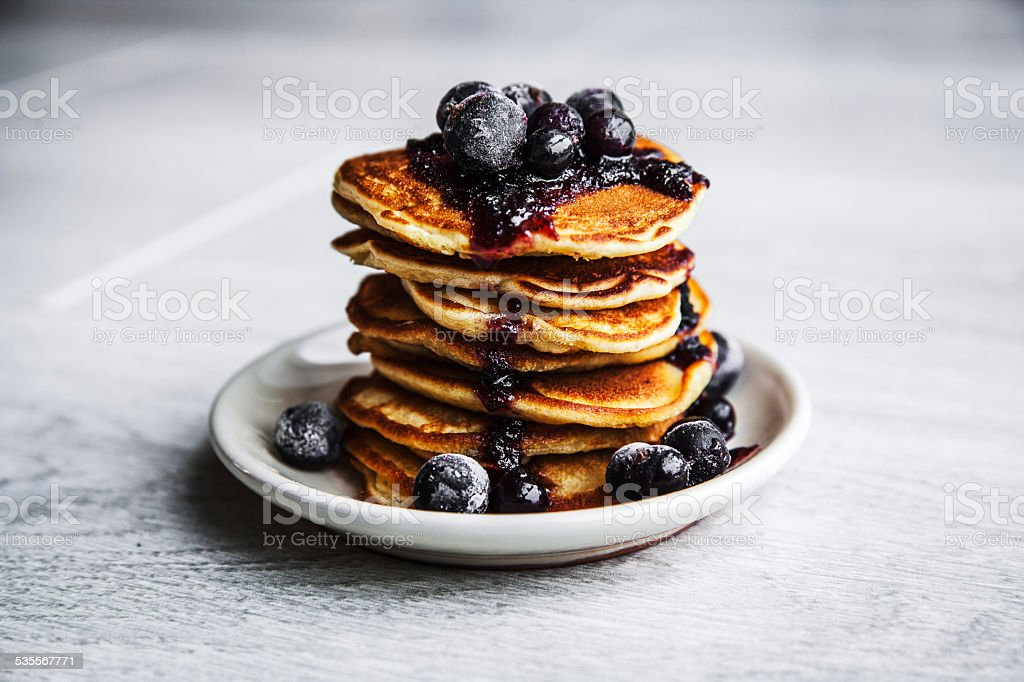 Picture of few pancakes with blackberries and sugar stock photo