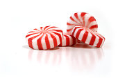 A picture of four peppermint candies on a white background