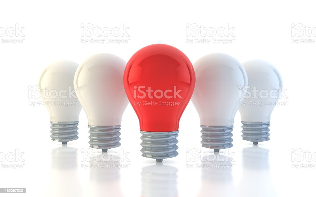 A picture of four white light bulbs and one white one stock photo