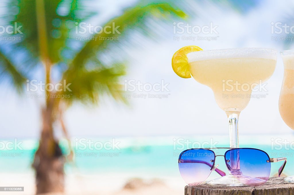 picture of fresh margarita and sunglasses on tropical beach stock photo