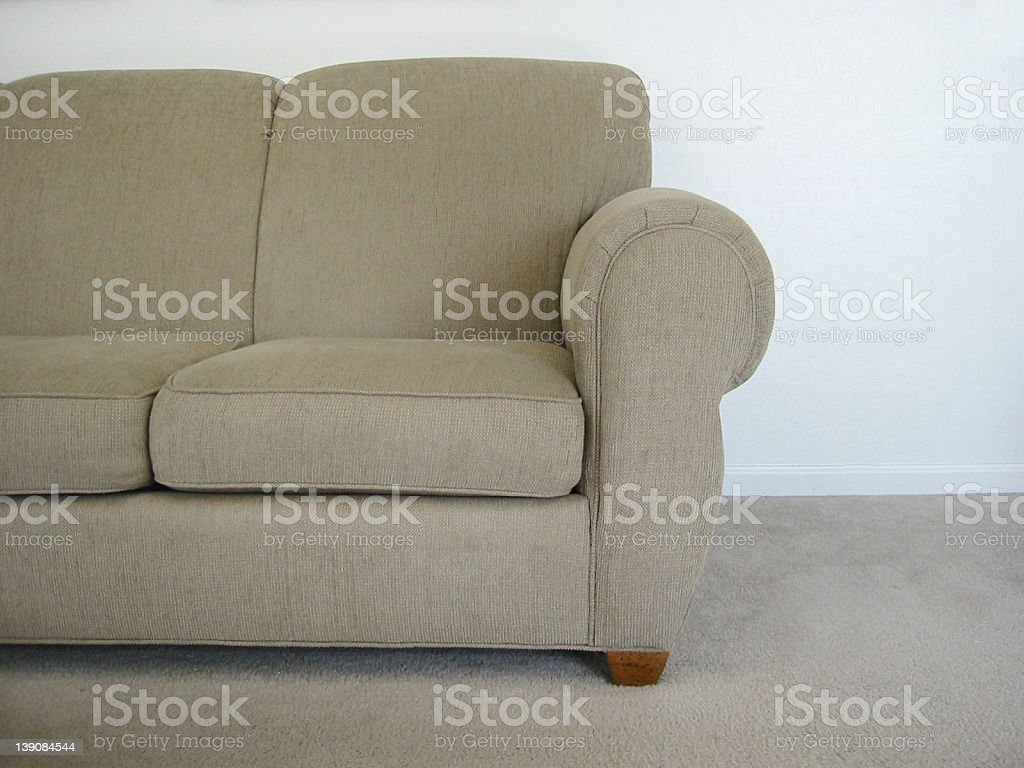 Picture of half of couch in a room with white walls royalty-free stock photo