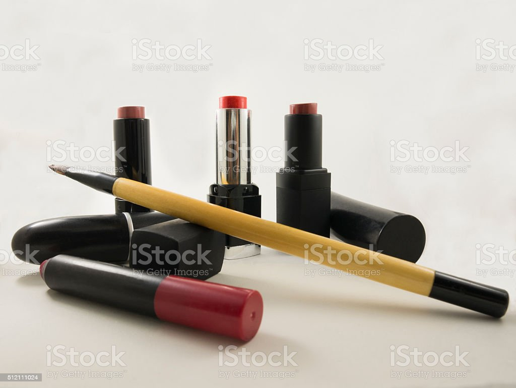 picture of lipsticks and brush stock photo