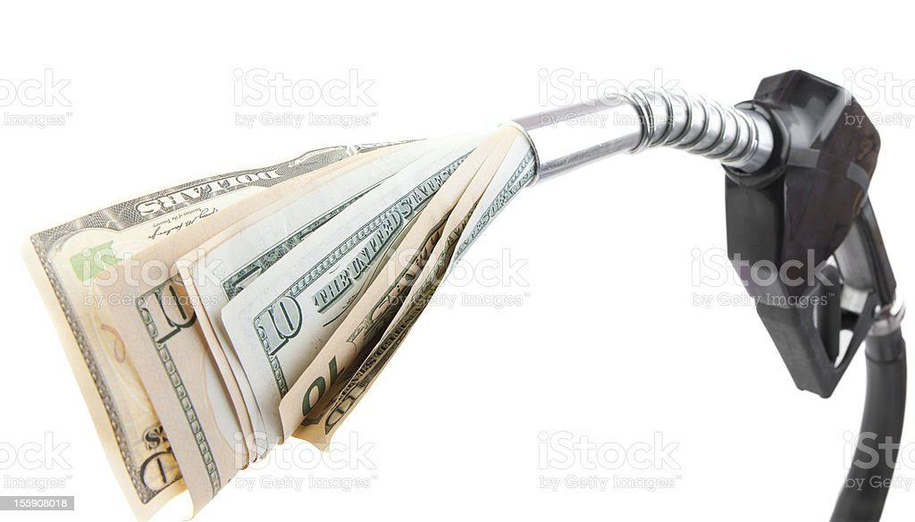 A picture of money in a gasoline pump symbolizing gas prices stock photo