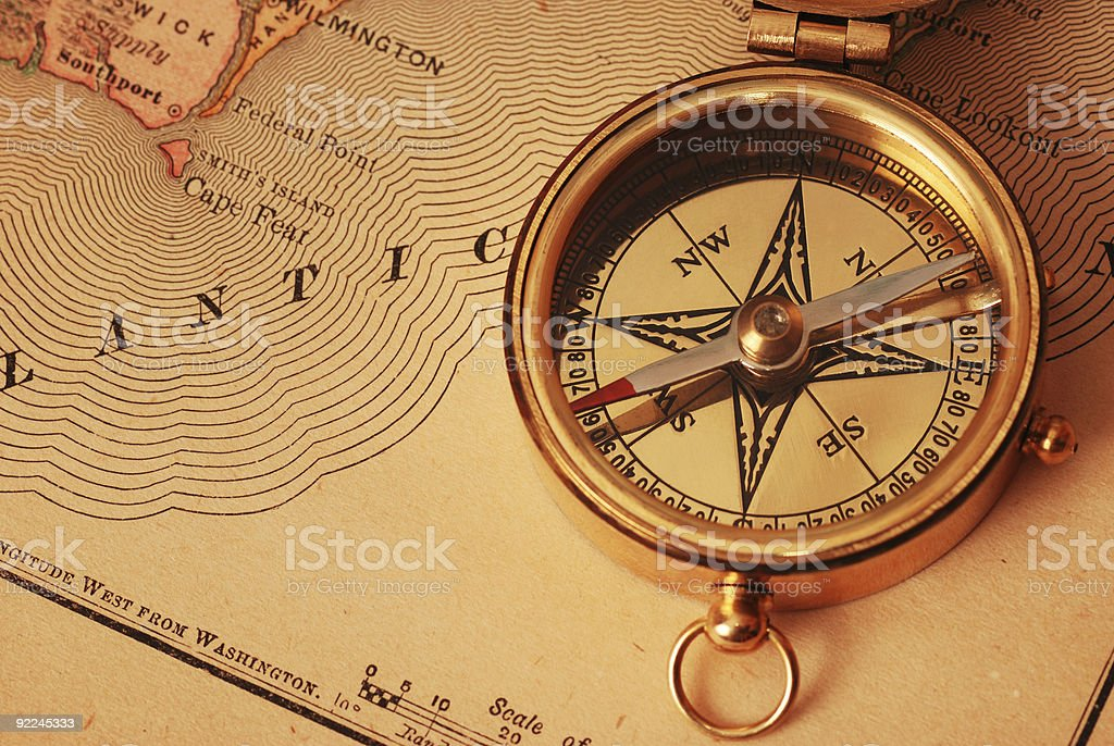 Picture of old brass compass over a map stock photo