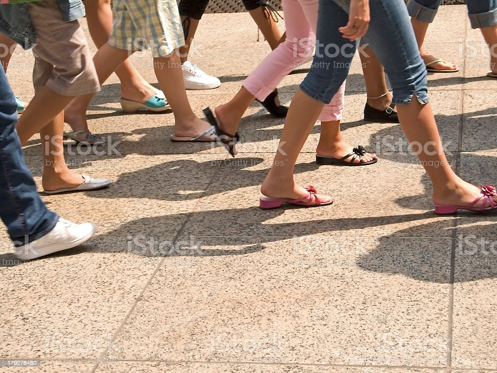 Picture of people legs walking on the street stock photo