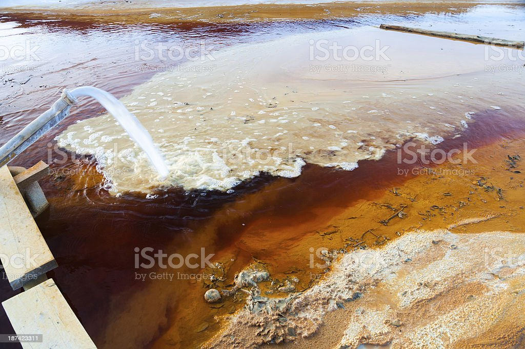 A picture of pollution and its effect on the water stock photo