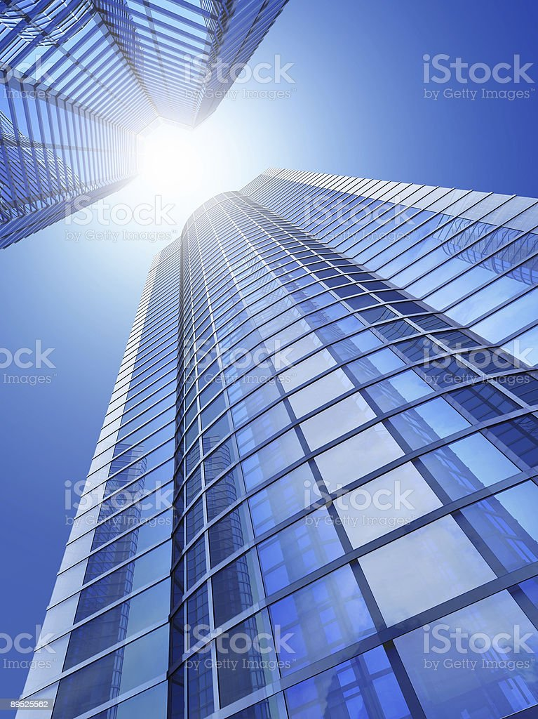 A picture of skyscrapers from a downward angle with sun beam royalty-free stock photo
