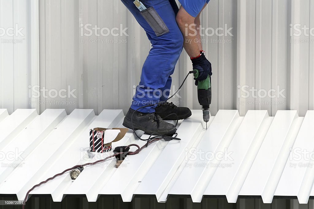 A picture of someone at work using a power tool stock photo