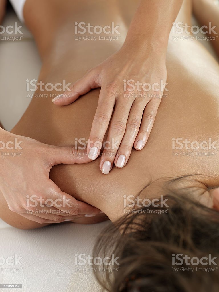 A picture of someone getting a massage royalty-free stock photo