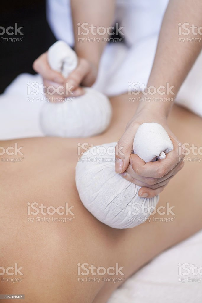 Picture of someone receiving a back massage with Thai balls royalty-free stock photo