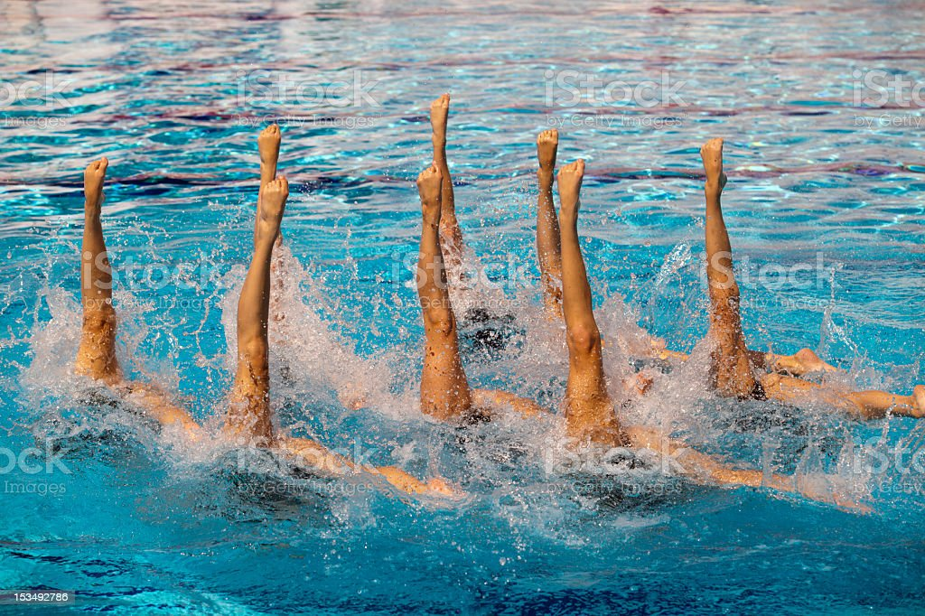 A picture of synchronized swimmers stock photo