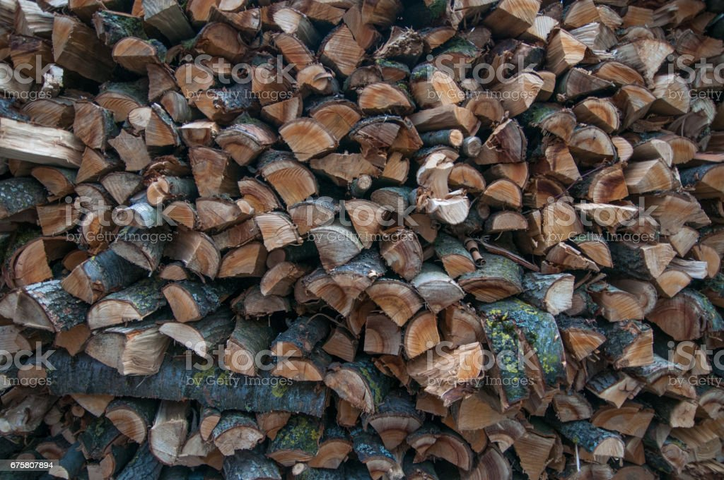 Picture of the firewood stack texture close up. Background of the firewood stack pattern close up stock photo