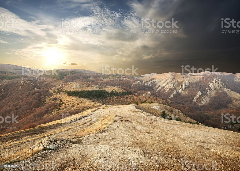 A picture of the mountains in autumn approaching sunset stock photo