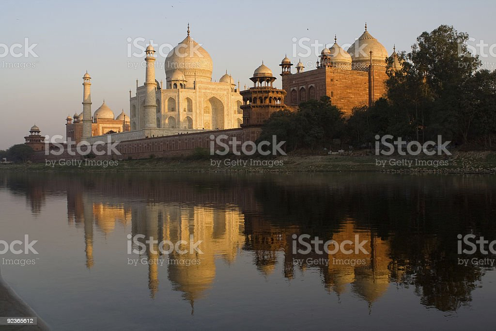 A picture of the Taj Mahal in front of water stock photo
