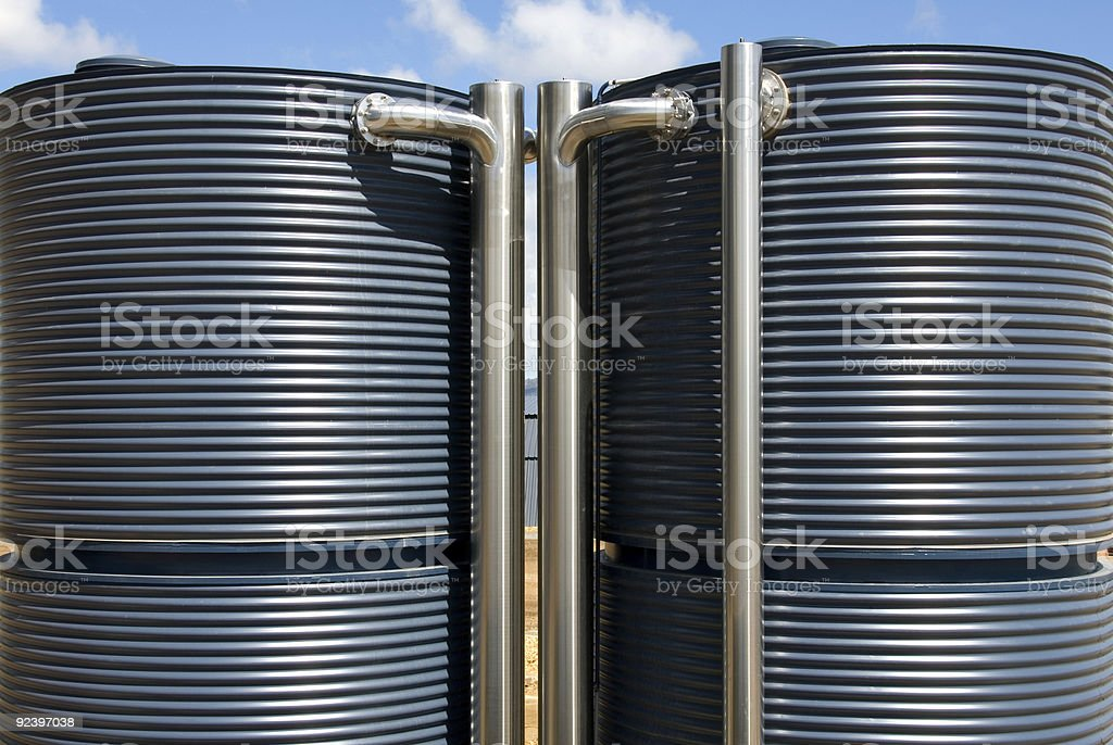 A picture of two blue water tanks stock photo
