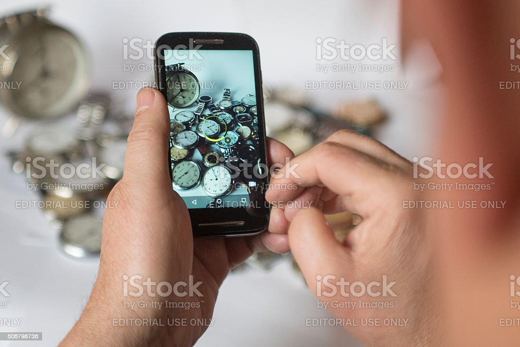 Picture of watch collection with a mobile phone stock photo