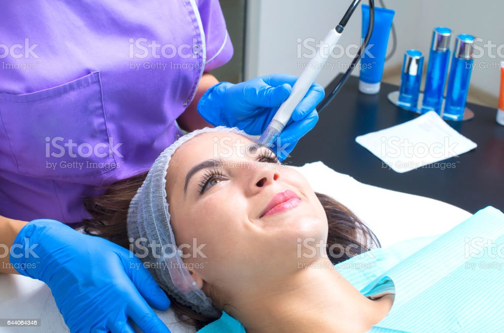 Picture of woman having facial treatment in beauty salon stock photo